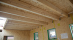 12mm-thick SWISS KRONO OSB/3 as wall panelling with 18mm-thick SWISS KRONO OSB/3 laid directly on joists to serve as the ceiling and the floor for the next storey.