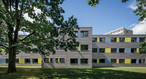A three-storey administration building created from timber modules for the German pension insurance organization