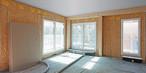 Vorgefertigte Wandelemente inkl. Fenster in Holzbauweise mit SWISS KRONO OSB/3