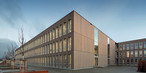 A school building made of timber modules consisting of SWISS KRONO LONGBOARD OSB