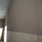 SWISS KRONO MAGNUMBOARD® OSB finished with KNAUF Rotkalk plaster